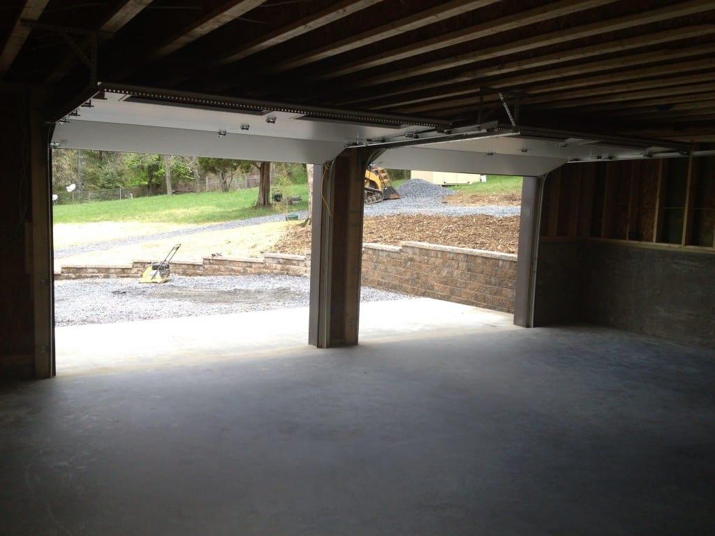 garage-door-opening-custom-two-story-garage-retaining-wall-site-preparation