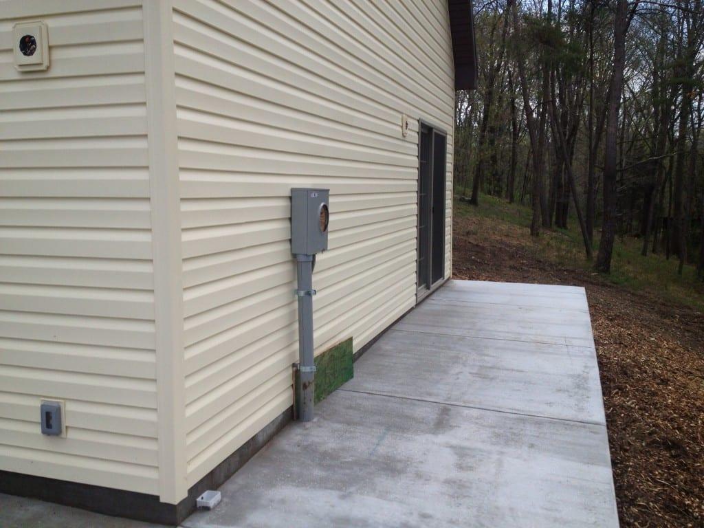 concrete-apron-custom-two-story-garage-retaining-wall-site-preparation