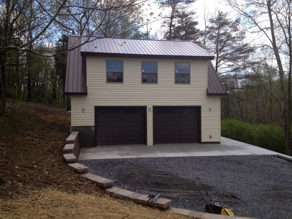 garage-door-view-of-custom-two-story-garage-retaining-wall-site-preparation