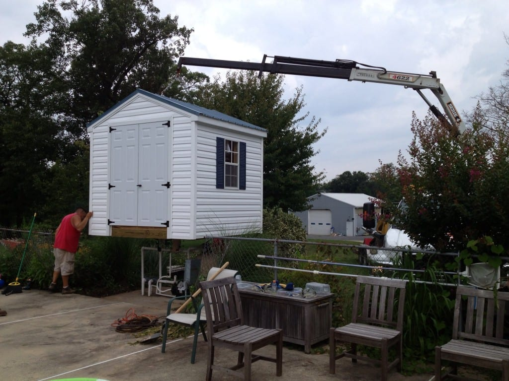 a-frame-vinyl-storage-shed-removed-with-crane-truck