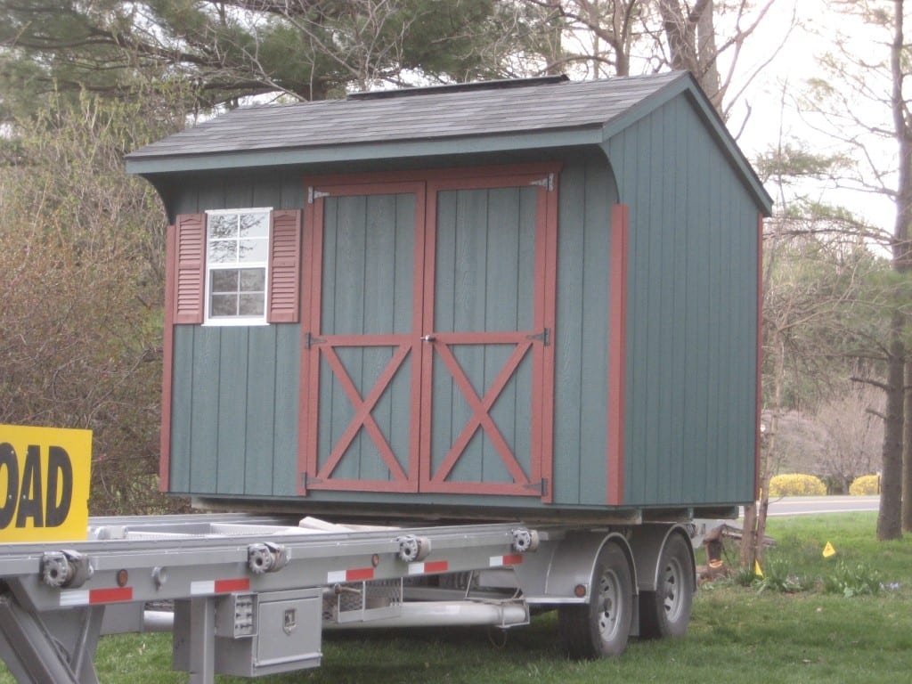 storage-shed-relocation-with-truck-and-trailer