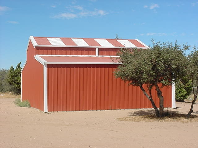 red-steel-framed-barn-with-metal-siding