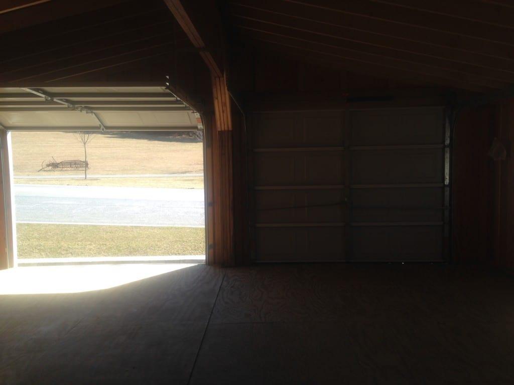 inside view of prefab modular two car garage with wood foor
