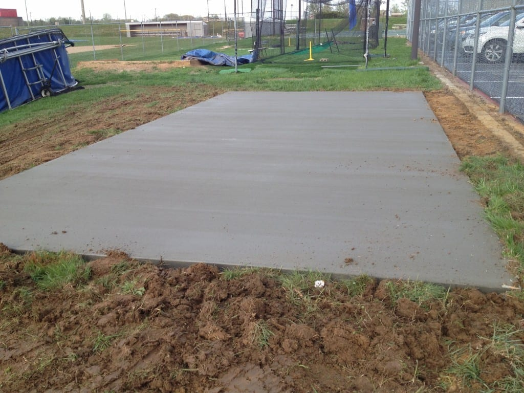 concrete pad completed for shed move of a large storage shed without flooring. move completed by 4-outdoor using special shed hauling trailers and equipment
