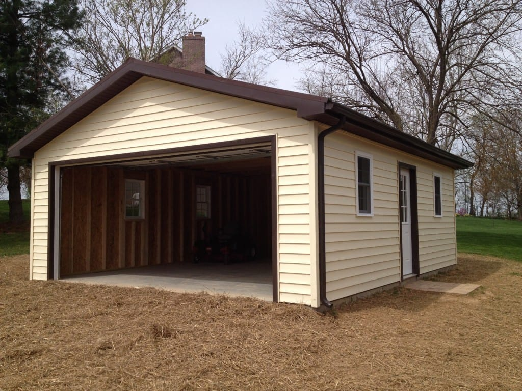 custom vinyl garage from the front right angle with garage door raised to show the concrete pad completed by 4-outdoor in walkersville md