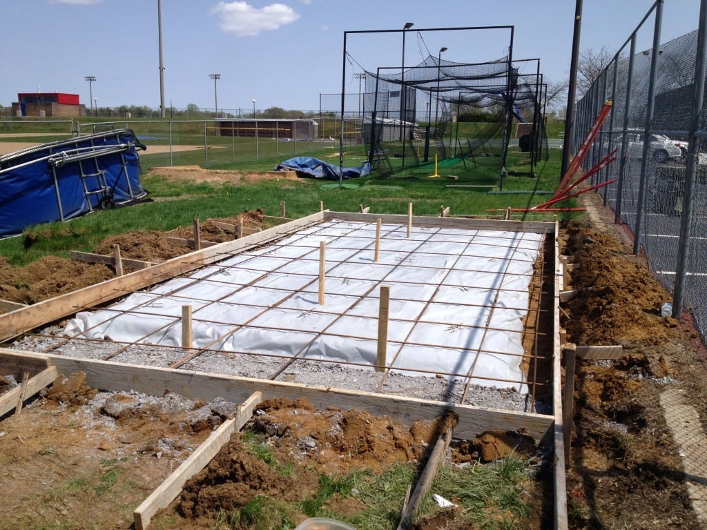 concrete pad completed with rebar for extra strength to hold the large storage shed moved onto concrete pad completed by 4-outdoor. 4-outdoor moved the storage shed in arnold md